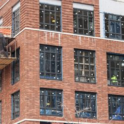 The condo building has unusually large windows on some of the lower floors, measuring eight feet tall in some cases.