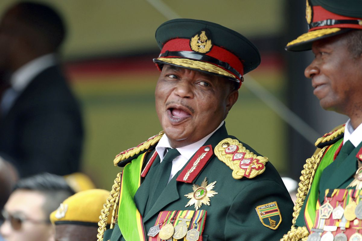 FILE - In this Friday, Nov. 24, 2017 file photo, Army General Constantino Chiwenga smiles during the presidential inauguration ceremony in the capital Harare, Zimbabwe. Zimbabwe's state-run media is reporting that new President Emmerson Mnangagwa has appo