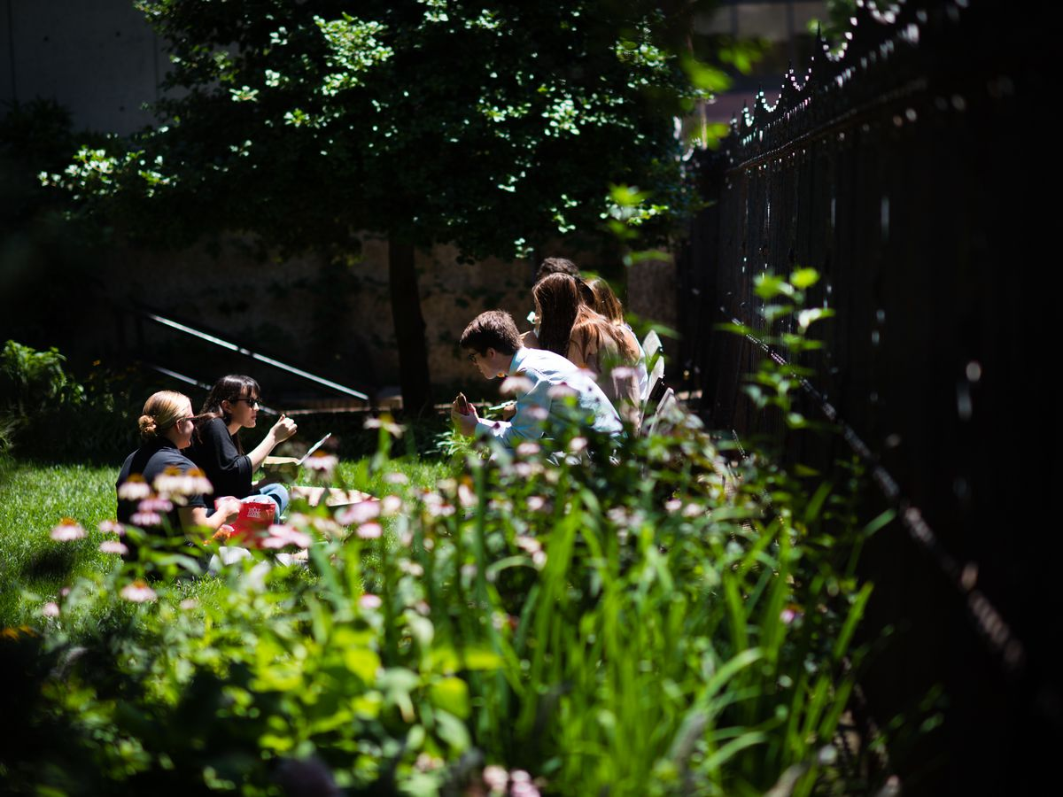 A group of people enjoy lunch in the back garden of the Heurich House in Dupont Circle.