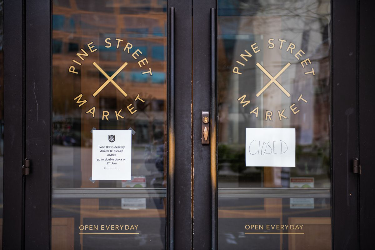 """The doors of Pine Street Market, housing several of Portland's popular dining spots, sporting a white, handwritten sign that reads """"closed"""" on Saturday, April 4. Next to the white sign, Pollo Bravo's white sign advertises its delivery and pickup options"""