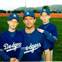 Daniel Sorensen and Brad Sorensen pose for a picture in their Dodger gear with their dad Kory. Kory, died April 3, 2019, after a battle with atypical Parkinson's disease. He was 65.