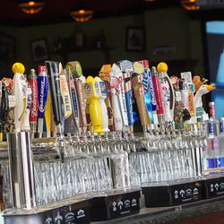 Tilted Kilt features 24 beers on tap, with the same number on the other side of the bar.