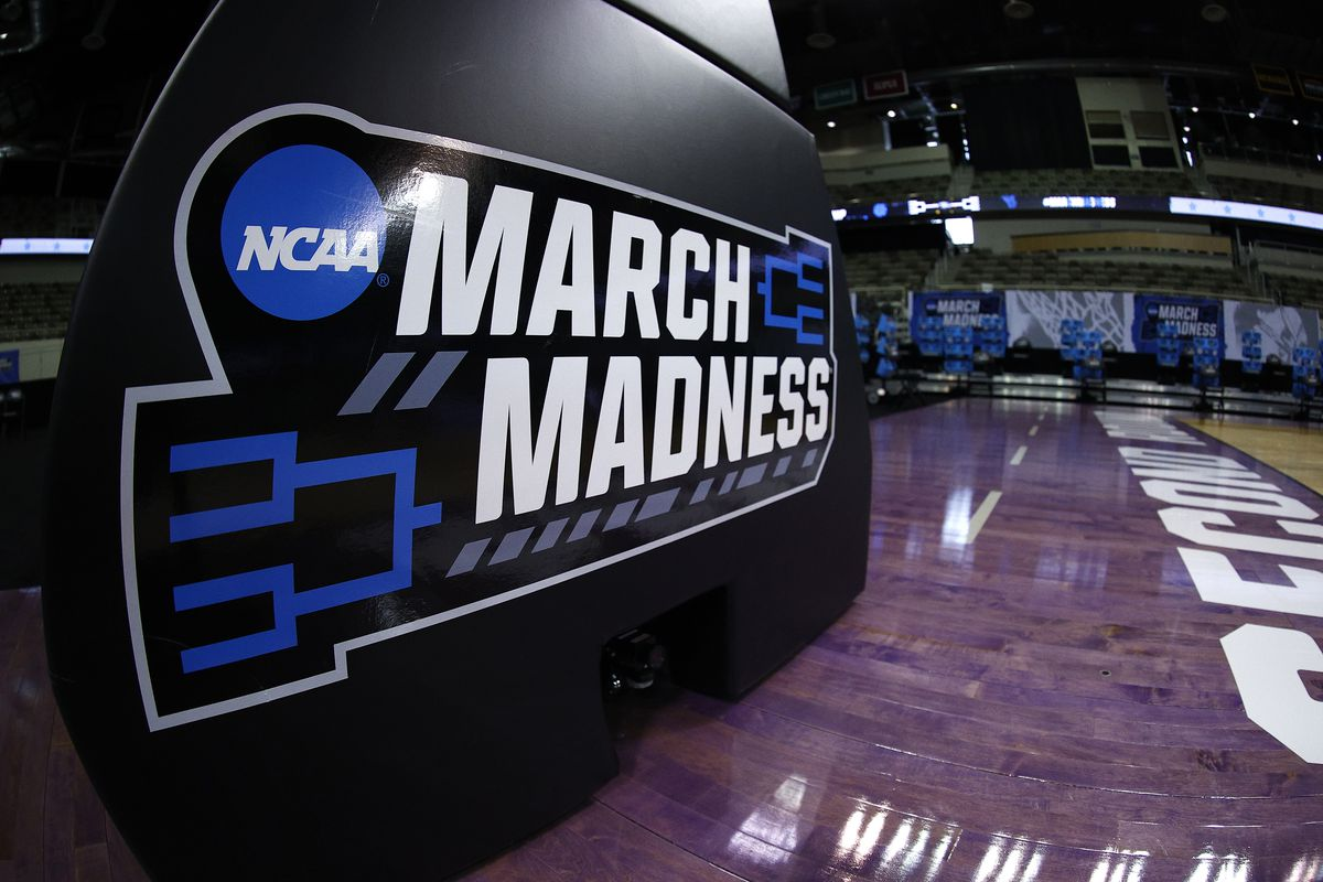 The NCAA March Madness logo is seen on the basket stanchion before the game between the Oral Roberts Golden Eagles and the Florida Gators in the second round game of the 2021 NCAA Men's Basketball Tournament at Indiana Farmers Coliseum on March 21, 2021 in Indianapolis, Indiana.