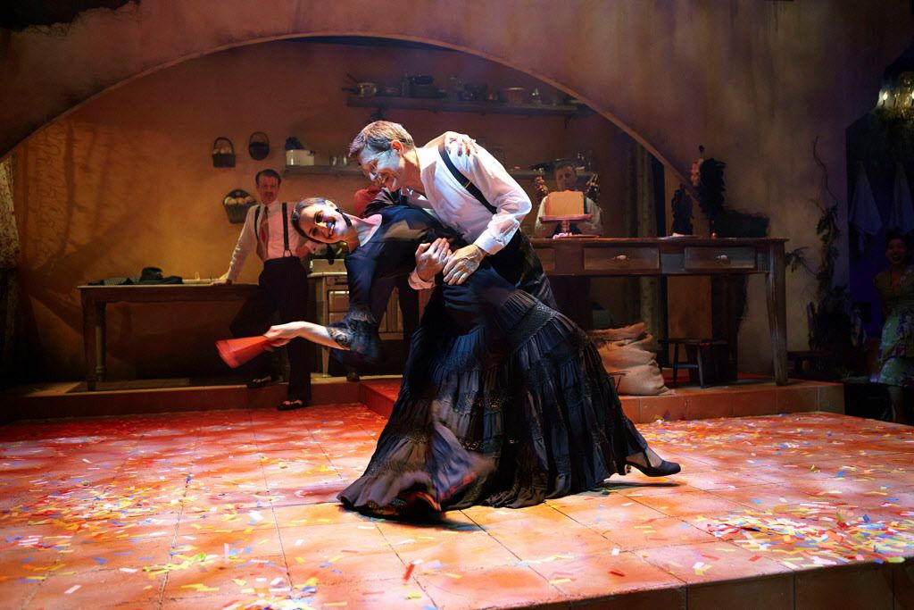 """""""Rick Bayless in Cascabel: Dining, Daring, Desire"""" features Rick Bayless as the Cook and Chiara Mangiameli as the Senora at Lookingglass Theatre. 