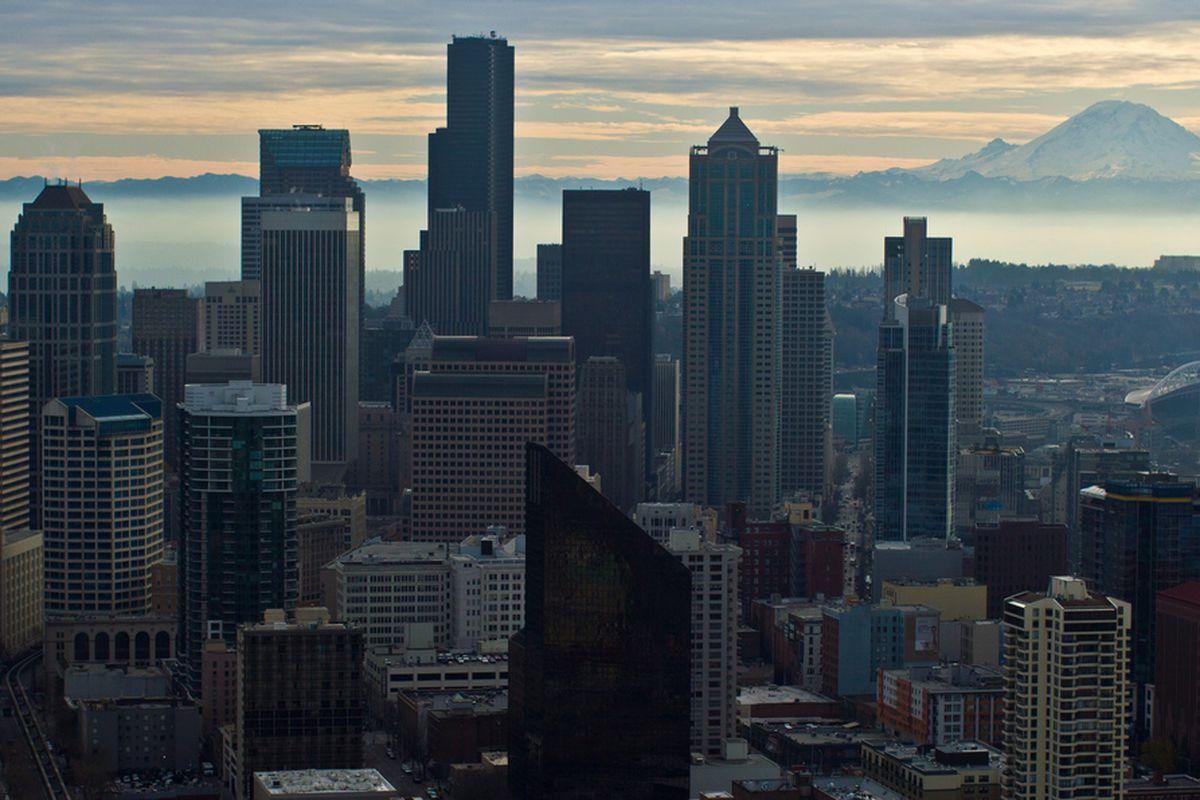 "<em>(via <a href=""http://en.wikipedia.org/wiki/File:Seattle_Close_Mt._Rainier_Victor_Grigas.jpg"" target=""new"">Wikipedia</a>) </em>"