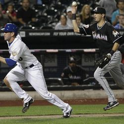 Miami Marlins shortstop Gil Velazquez, right, runs down New York Mets' Josh Thole during the second inning of a baseball game on Friday, Sept. 21, 2012, in New York. Thole was out on the play.