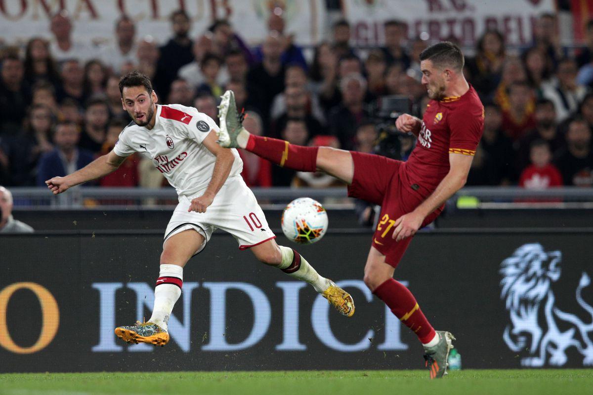 Hakan Calhanoglu ( Milan ) kicks the ball while Jordan...