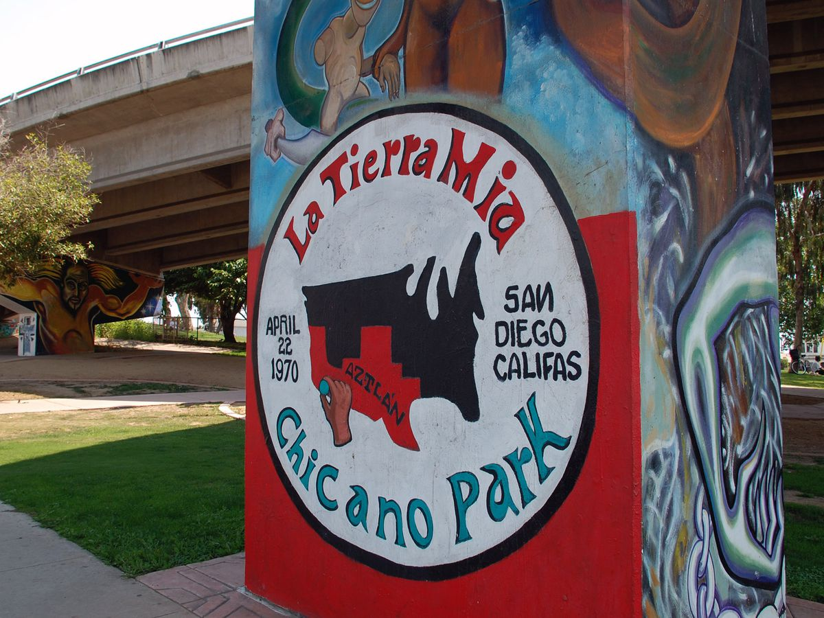 A mural with a sign that reads: La Tierra Mia Chicano Park.