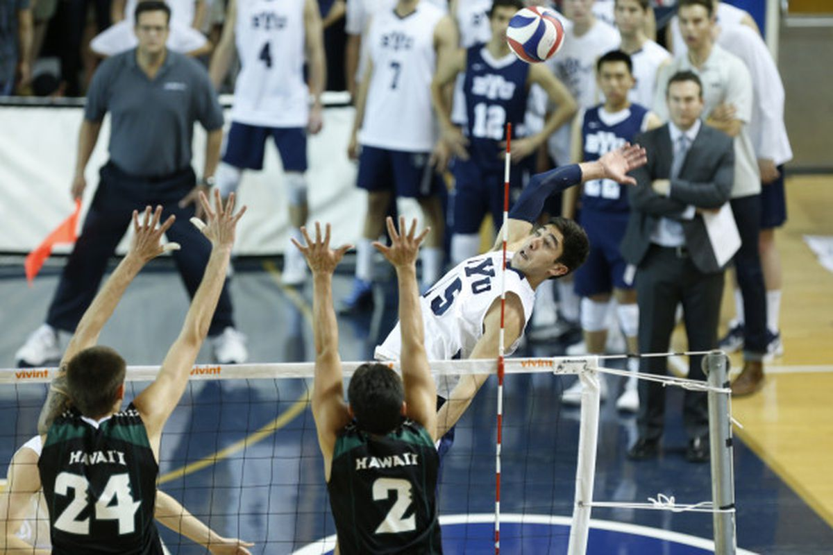 BYU's Taylor Sander puts down a kill over Hawaii's Joby Ramos, right, and Davis Holt in Friday's MPSF quarterfinal at Provo, Utah. BYU won the match, 25-19, 20-25, 22-25, 25-12, 15-13.