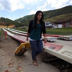 Laura Hadfield gets off the alpine slide at Park City Mountain Resort in Park City on Friday, Sept. 5, 2014.