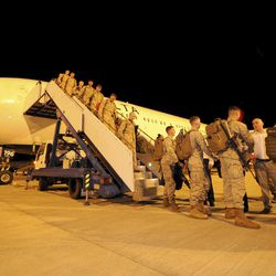 In this photo released by the Australian Department of Defense, U.S. Marine Corps, Fox Company, 2nd Battalion 3rd Marine Regiment arrive at the Royal Australian Air Force Base in Darwin, Australia, Tuesday night, April 3, 2012. The first detachment of 200 U.S. Marines has arrived in northern Australia, where a permanent joint training hub is taking shape as part of a U.S. shift of military strength in the Asia-Pacific region.