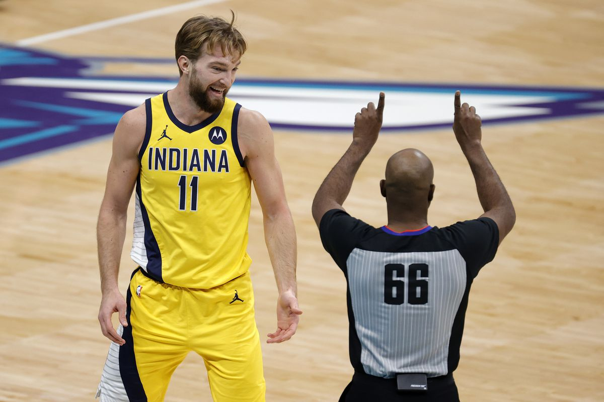 Domantas Sabonis of the Indiana Pacers reacts as referee Haywoode Workman makes a call during the first quarter of their game against the Charlotte Hornets at Spectrum Center on January 29, 2021 in Charlotte, North Carolina.
