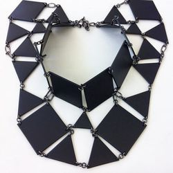 """An amazing geometric neckpiece from Bliss Lau's """"Facet"""" collection."""
