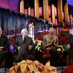 Mormon Tabernacle Choir director Mack Wilberg, author David McCullough, singer Natalie Cole and choir president Mac Christensen speak to the media about the annual Christmas concert at the Conference Center in Salt Lake Friday.