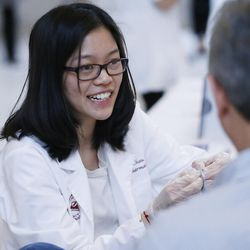 Tiffany Chau does a cholesterol check with other University of Utah and Roseman University students during Pharmacy Day in the Capitol rotunda in Salt Lake City on Tuesday, Jan. 31, 2017. During the event, pharmacy students put on a health fair and poster presentations for legislators. The health fair included blood pressure, glucose and cholesterol screenings.