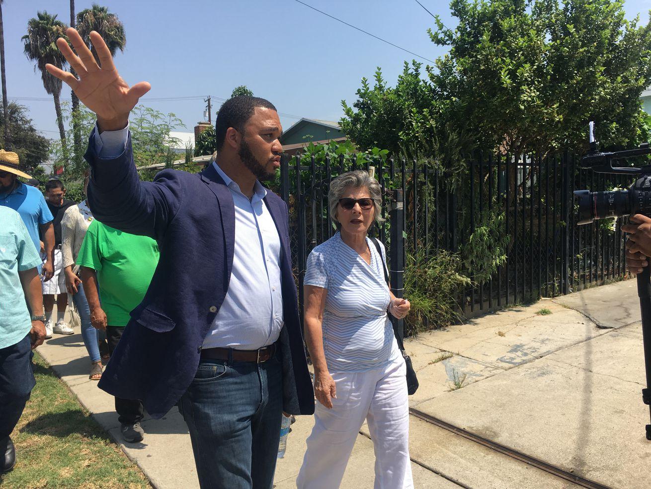 D'Artagnan Scorza, with Uplift Inglewood, walks with former Sen. Barbara Boxer on Doty Avenue.