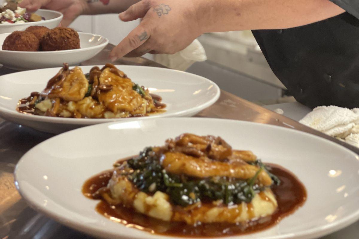 Chef John Hults plates food at newly opened Atlantic Station restaurant Toscano Ristorante Italiano in Atlanta.