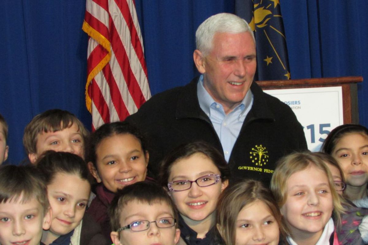 Gov. Mike Pence poses with students from Indianapolis' St Therese Little Flower Catholic School at an annual school choice rally sponsored by the Friedman Foundation in 2015.