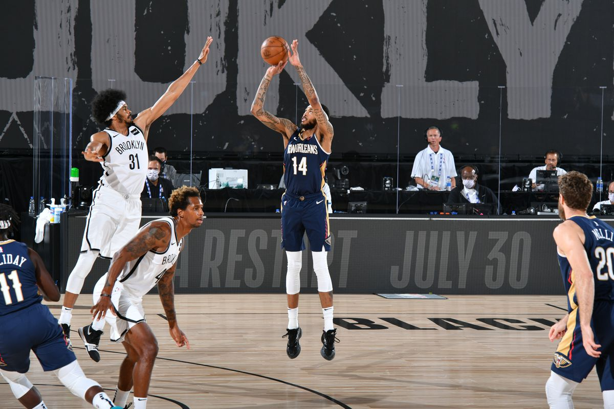 Brandon Ingram of the New Orleans Pelicans shoots three point basket against the Brooklyn Nets on July 22, 2020 at The Arena at ESPN Wide World of Sports Complex in Orlando, Florida.