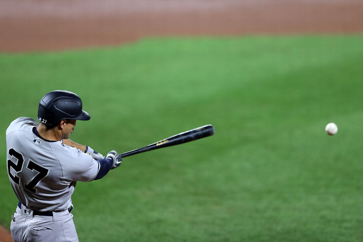 Giancarlo Stanton #27 of the New York Yankees hits the ball against the Baltimore Orioles at Oriole Park at Camden Yards on July 29, 2020 in Baltimore, Maryland.