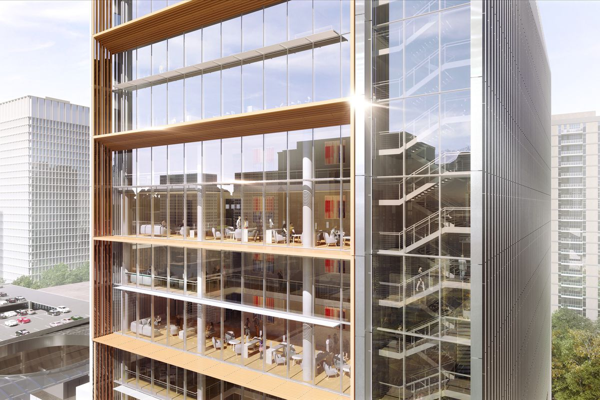 Rendering of building with glass walls, revealing lounges, stairways and other spaces.