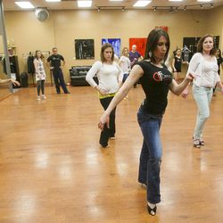 South Salt Lake Businesswoman of the Year Maria Ivanova teaches salsa steps to the women in class Tuesday, March 12, 2013, at her dance studio, DF Dance.