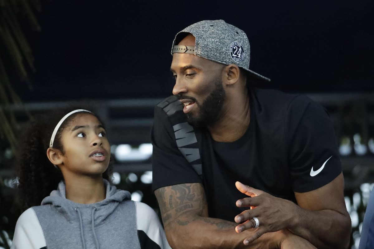 Kobe Bryant talks to his daughter Gianna in this 2018 photo. The pair died in a helicopter crash on Sunday.