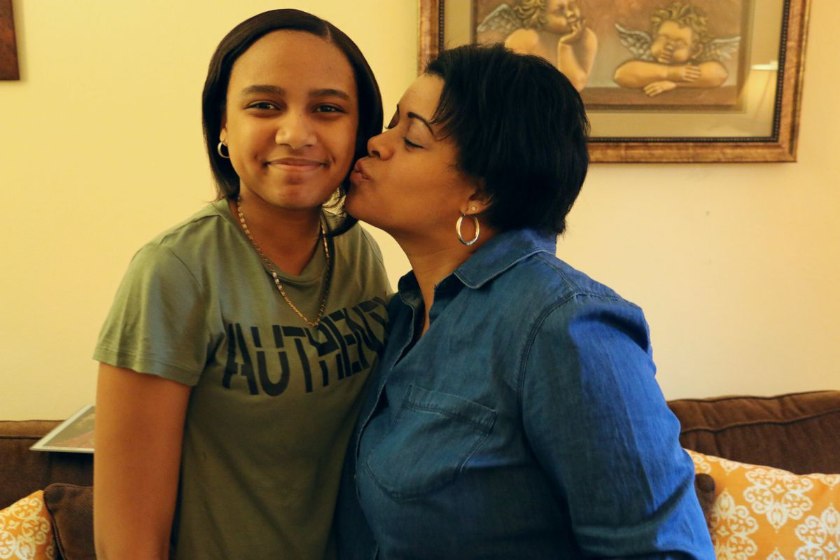 Aaliyah Santana, a P.S. 191 eighth-grader who's graduating this month, with her mother, Joselin (Photo: Patrick Wall)