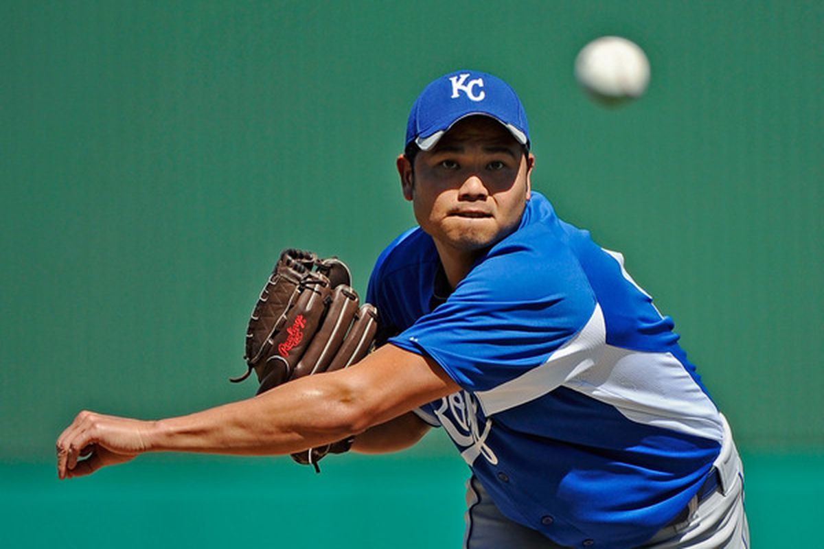 MESA, AZ - MARCH 09:  Pitcher Bruce Chen #52 of the Kansas City Royals throws a ptich against the Chicago Cubs during the spring training baseball game at HoHoKam Stadium on March 9, 2011 in Mesa, Arizona.  (Photo by Kevork Djansezian/Getty Images)