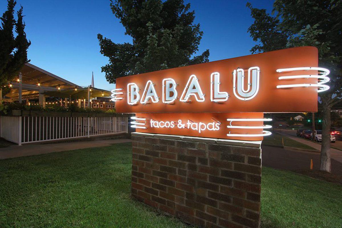 A neon sign for Babalu Tacos & Tapas.