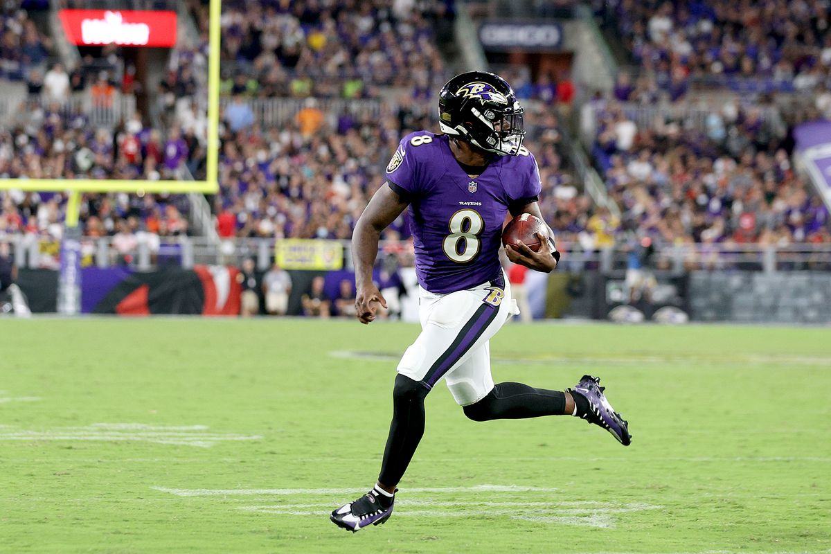 Lamar Jackson #8 of the Baltimore Ravens rushes for a touchdown against the Kansas City Chiefs during the fourth quarter at M&T Bank Stadium on September 19, 2021 in Baltimore, Maryland.