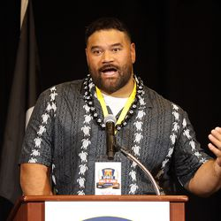NFL football player Haloti Ngata speaks as he is honored at the Utah Sports Hall of Fame Foundation banquet at the Little America Hotel in Salt Lake City on Monday, Sept. 20, 2021.