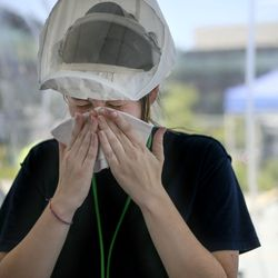 Chandler Squier, MA, wipes the sweat off her face while working at a COVID-19 test center at at Intermountain Healthcare's Salt Lake Clinic on Friday, July 10, 2020. Officials from Intermountain Healthcare, University of Utah Health, MountainStar Healthcare and Steward Health Care fear that if COVID-19 cases continue to spike, they will no longer be able to effectively manage all the patients.