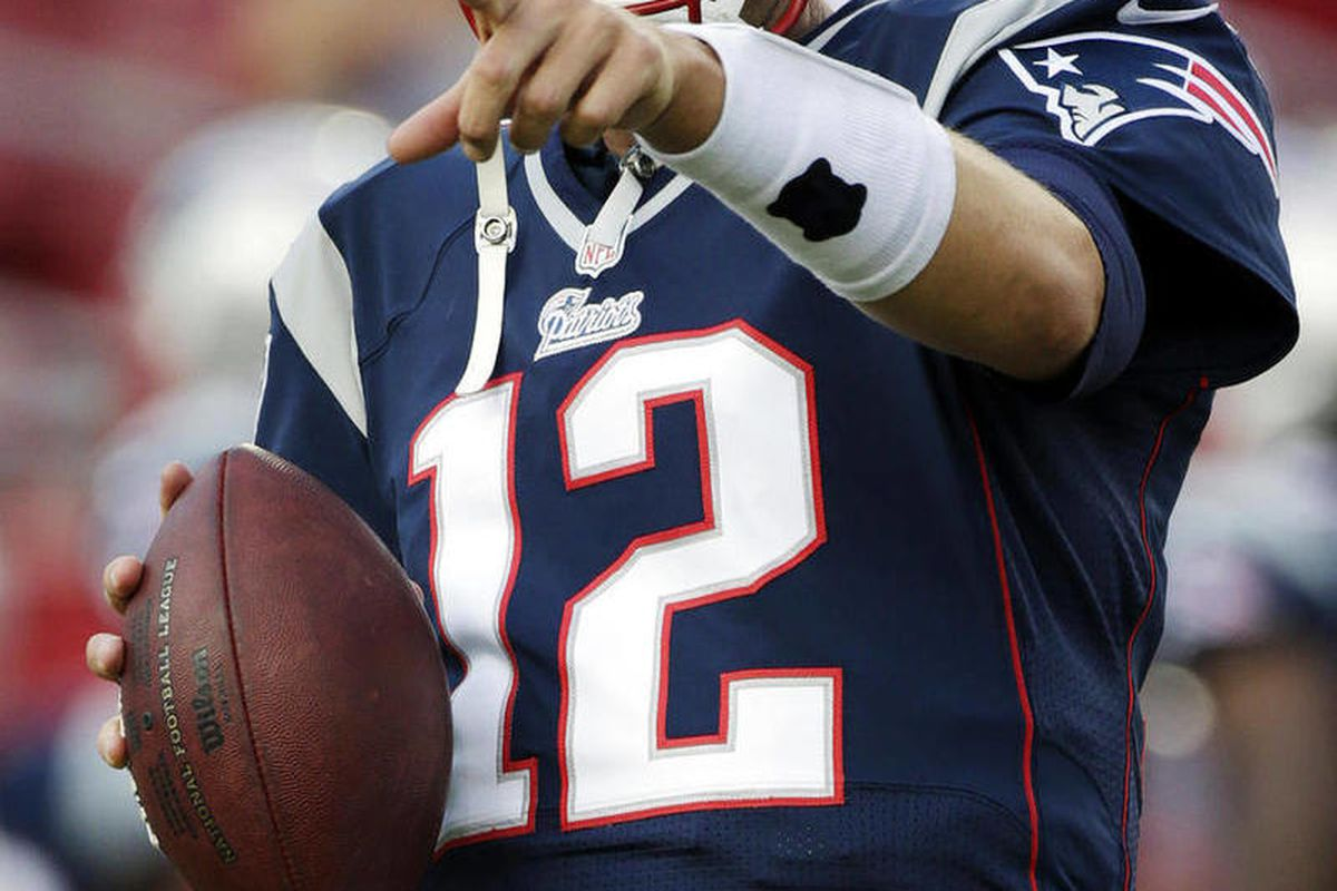 FILE - In this Aug. 24, 2012, file photo, New England Patriots quarterback Tom Brady warms up prior to an NFL preseason football game against the Tampa Bay Buccaneers in Tampa, Fla. The Patriots followed up a season that saw them lose just three regular-s