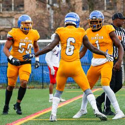Simeon's Jacquez Woodland (1) celebrates with Chau Smith (6) after Smith's touchdown against Lakes.