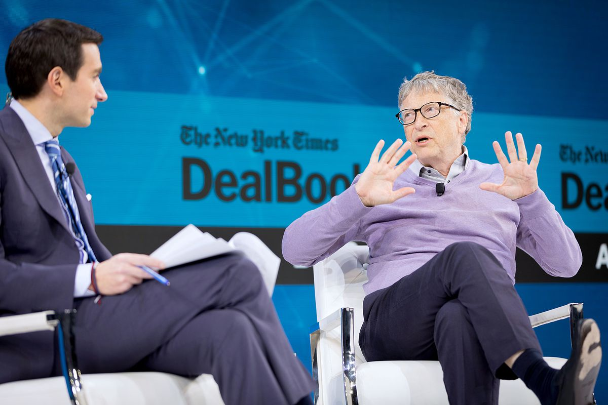 Andrew Ross Sorkin interviews Bill Gates at a New York Times conference.