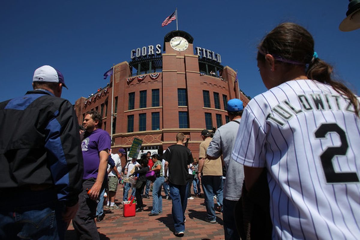 Fans head for the gates of the stadium as the Colorado Rockies play at Coors Field in Denver, Colorado.  (Photo by Doug Pensinger/Getty Images)
