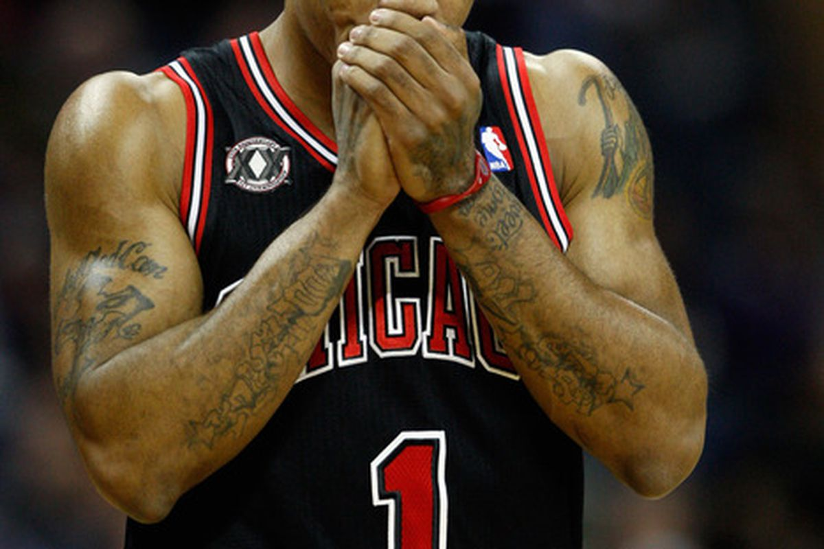 Derrick Rose makes his 2nd wish: some help. He then regrets spending his first wish on that Skittles machine. (Photo by Streeter Lecka/Getty Images)