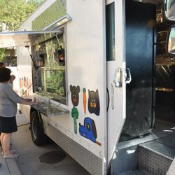 Guests lining up at the H-Town StrEATS food truck for the first course.