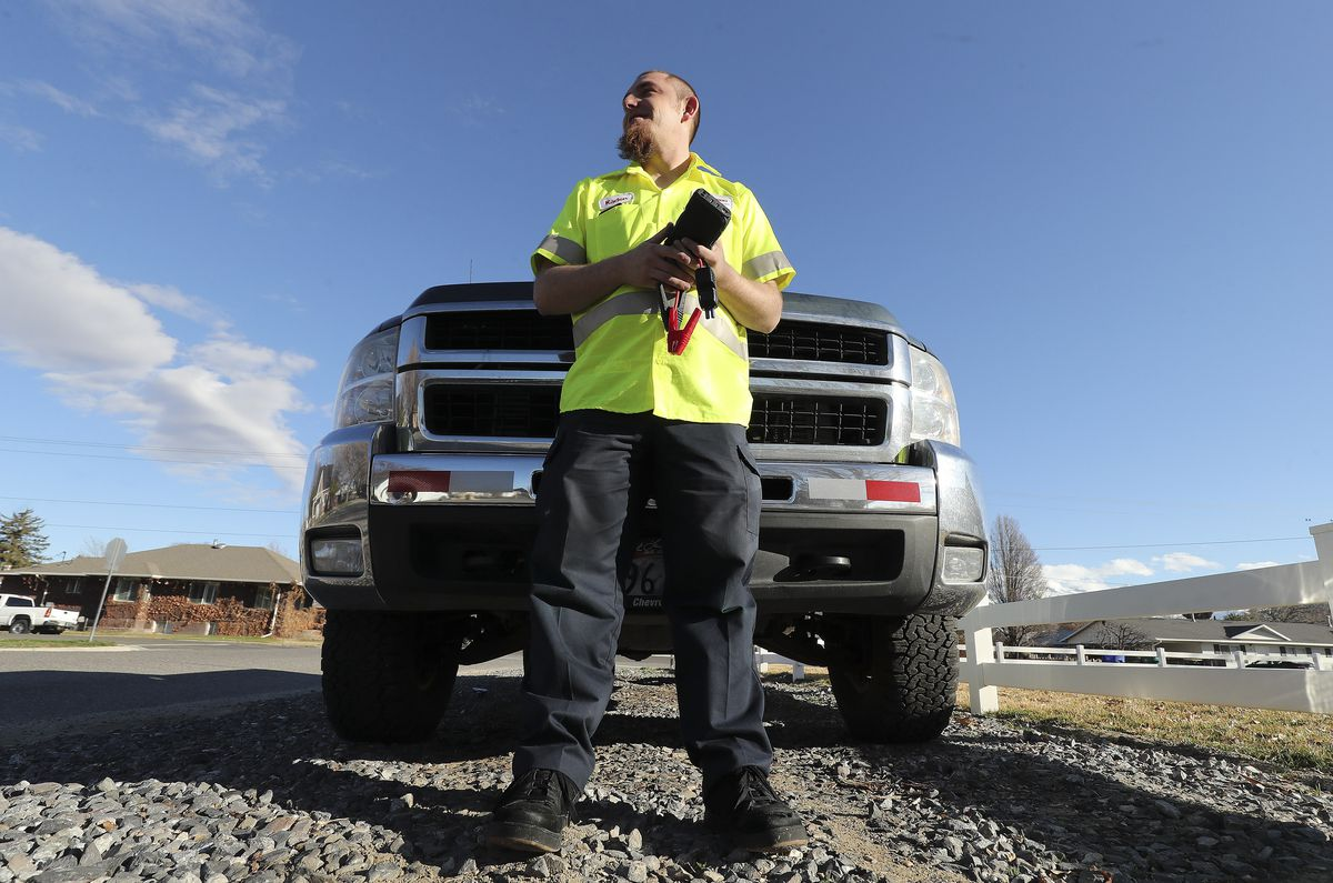 Kaden Mattinson stands by his work truck in Lehi on Tuesday, March 17, 2020. Mattinson started a roadside assistance business five months ago and was doing well until about three weeks ago when the coronavirus began to spread.
