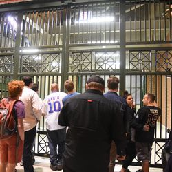 8:48 p.m. Limited view at Gate Q, with a green mesh screen over the inner gate doors -