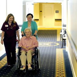 Vicki Bradford helps wheel out her mom Myrl Warner with Mary Cannon Jones at the Legacy House in Spanish Fork on Tuesday, March 18, 2014.