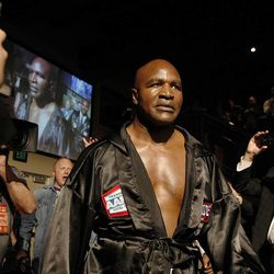 Five-time heavyweight champion Evander Holyfield enters the ring ahead of his fight against former Massachusetts Gov. Mitt Romney during the Charity Vision Fight Night event in Salt Lake City, Friday, May 15, 2015.