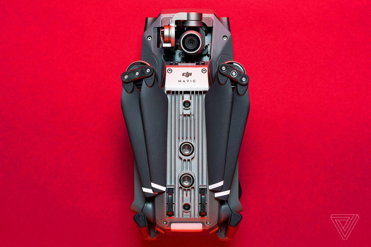 DJI Mavic Pro drone closed on red background