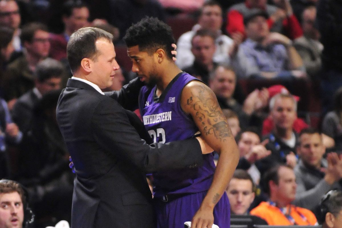 Chris Collins hugs JerShon Cobb after a 56-71 loss to the Indiana Hoosiers