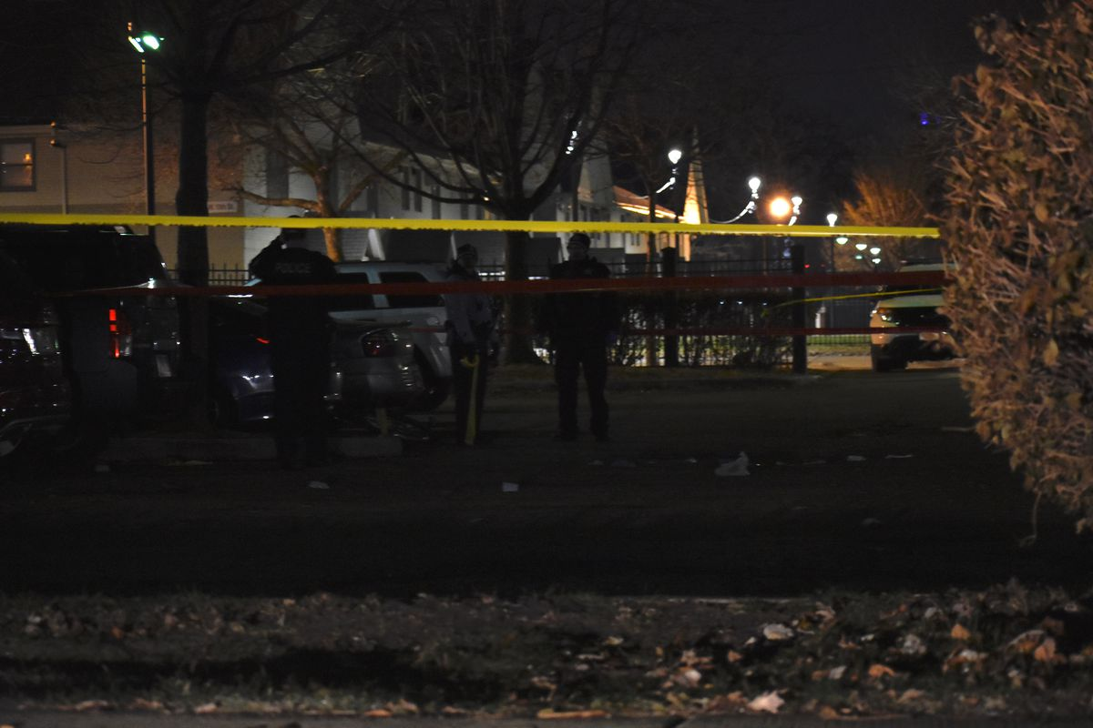 Police investigate the scene where a man was fatally shot Nov. 22, 2019, in the 1200 block of South Throop Street in University Village.
