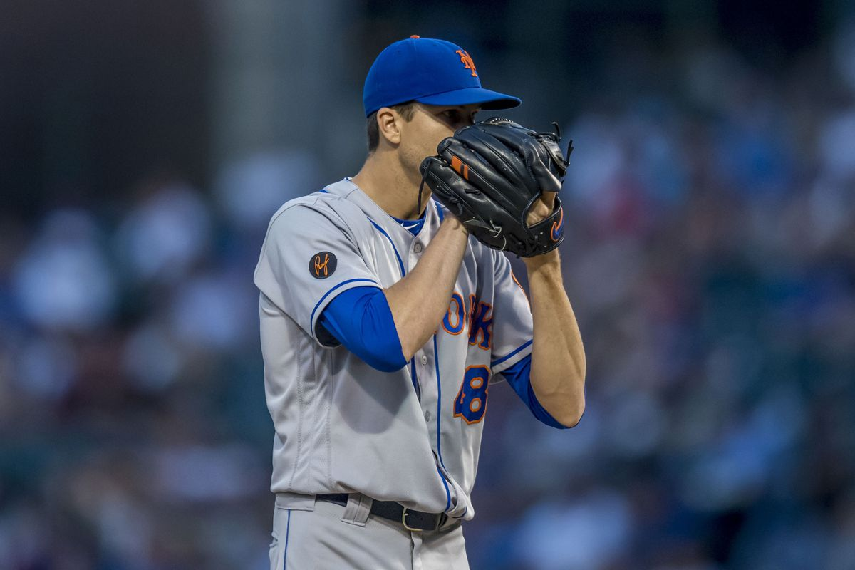 New York Mets starting pitcher Jacob DeGrom prepares to pitch during the first inning against the Chicago Cubs at Wrigley Field.