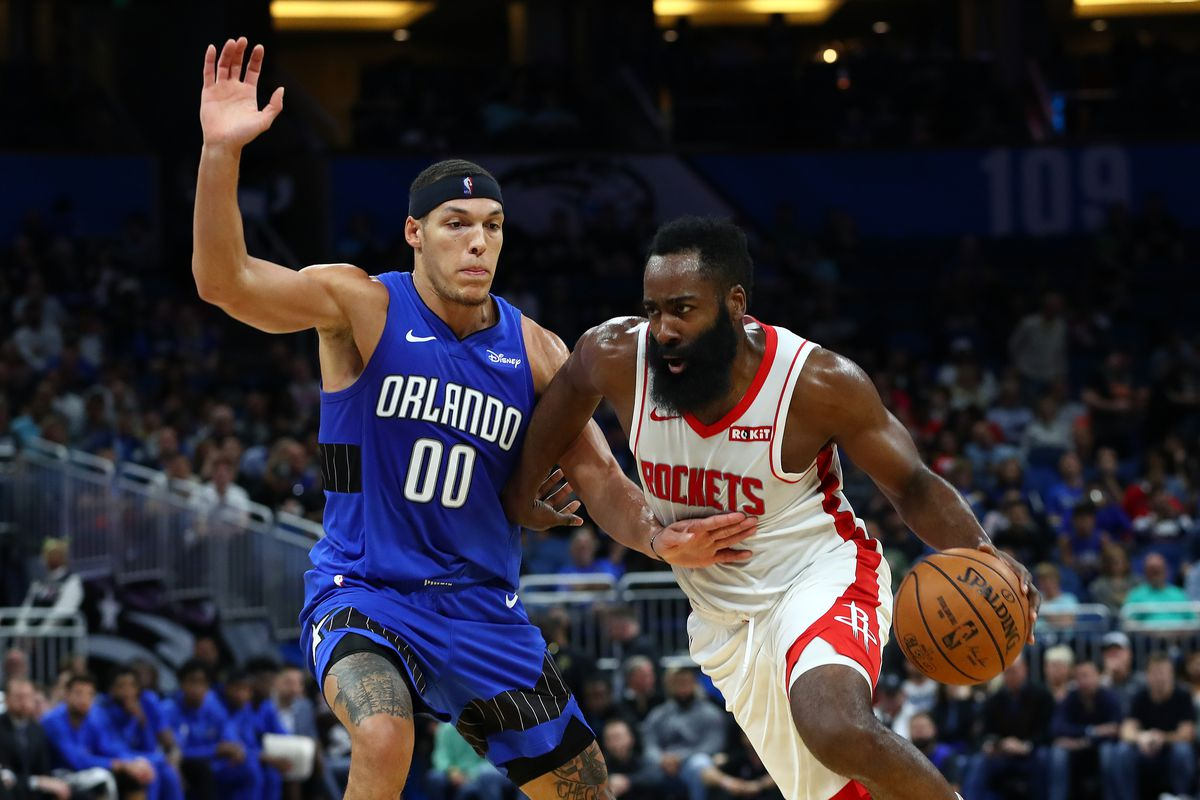 Houston Rockets guard James Harden drives to the basket as Orlando Magic forward Aaron Gordon defends during the second quarter at Amway Center.