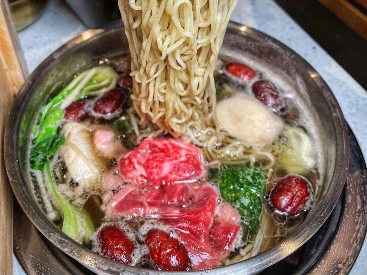 A noodle pull over a hot pot