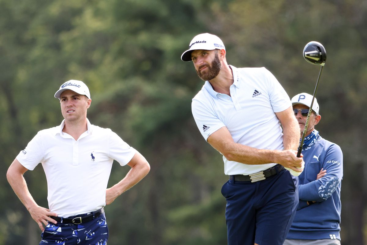 Dustin Johnson of the United States plays a shot as Justin Thomas of the United States and Claude Harmon III looks on during a practice round prior to the 120th U.S. Open Championship on September 16, 2020 at Winged Foot Golf Club in Mamaroneck, New York.